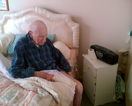 Grandpa sitting on his bed